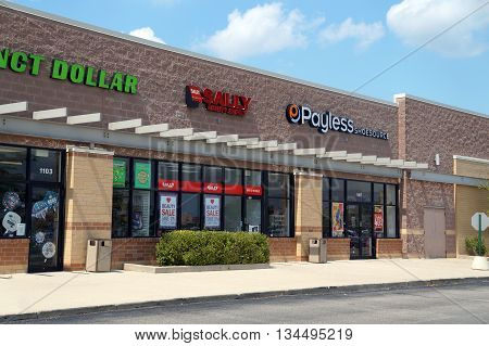SHOREWOOD, ILLINOIS / UNITED STATES - AUGUST 16, 2015: One may purchase beauty products at Sally Beauty Supply, and shoes at the Payless Shoe Source, in a Shorewood strip mall.