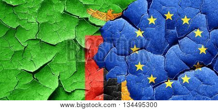Zambia flag with european union flag on a grunge cracked wall