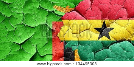 Zambia flag with Ghana flag on a grunge cracked wall