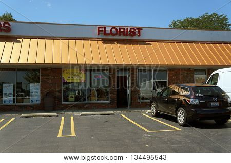 SHOREWOOD, ILLINOIS / UNITED STATES - AUGUST 21, 2015: One may purchase flowers at So Dear to Pat's Heart Floral, in a Shorewood strip mall.