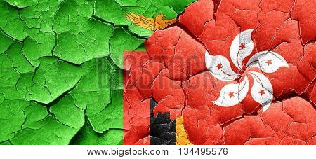 Zambia flag with Hong Kong flag on a grunge cracked wall