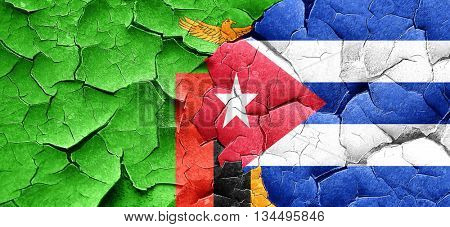 Zambia flag with cuba flag on a grunge cracked wall