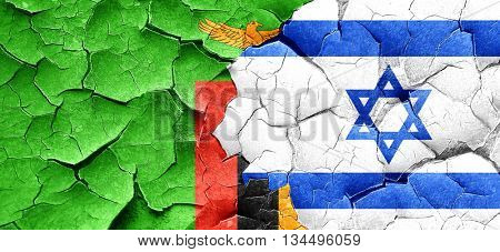 Zambia flag with Israel flag on a grunge cracked wall