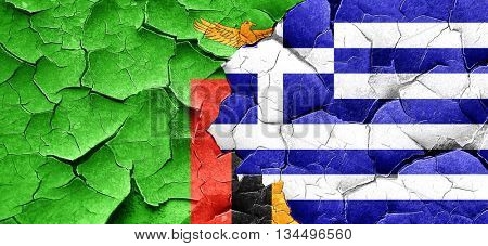 Zambia flag with Greece flag on a grunge cracked wall