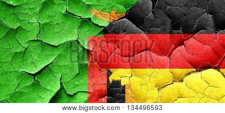 Zambia flag with Germany flag on a grunge cracked wall