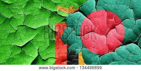 Zambia flag with Bangladesh flag on a grunge cracked wall