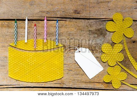 Beeswax, Cake With Candles And Flowers On Wooden Table, Empty Sign