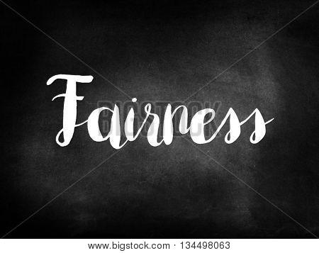 Fairness written on blackboard