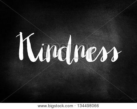 Kindness written on blackboard