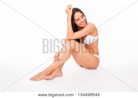 Portrait Of Sexy Brunette In White Underwear Sitting On White Background