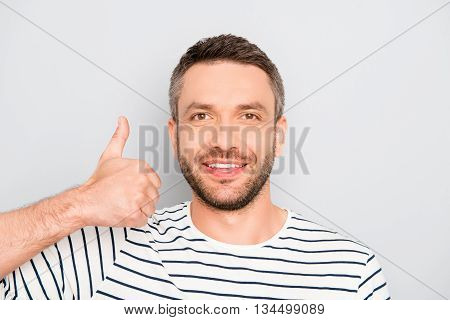 Portrait Of Happy Young Handsome Man Gesturing