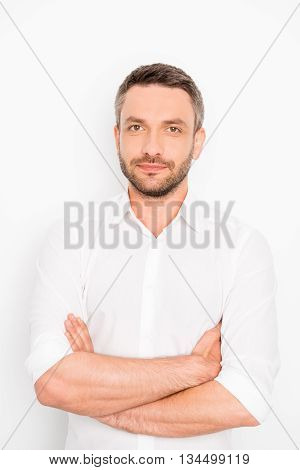 Portrait Of Confident Professional Businessman With Crossed Hands
