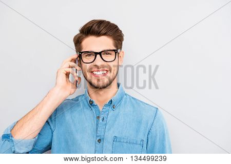 Successful Smart Businessman In Glasses Talking With Clients On Phone