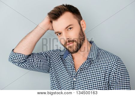 Portrait Of Healthy Man Combing His Hair With Fingers