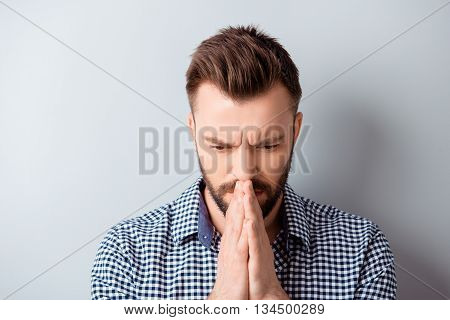 Portrait Of Young Bearded Man In Shirt Praying And Waiting