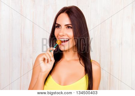 Portrait Of Happy Pretty Woman Licking Chupa Chups