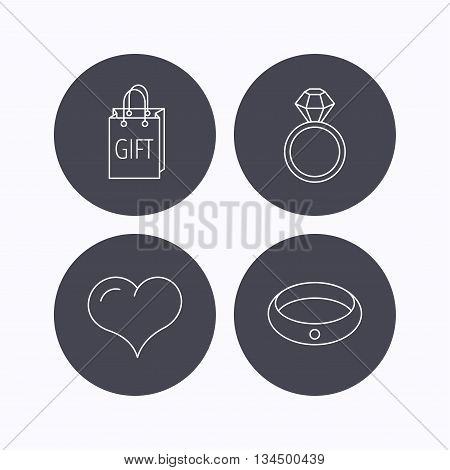 Love heart, gift bag and wedding ring icons. Engagement ring linear sign. Flat icons in circle buttons on white background. Vector