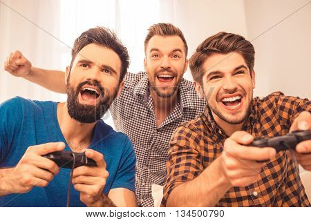 Yeah! Close Up Photo Of Excited Happy Cheerful Men Play Video Game