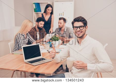 Handsome Businessman Sitting With Glasses And Cup At Conference And Have Break Time