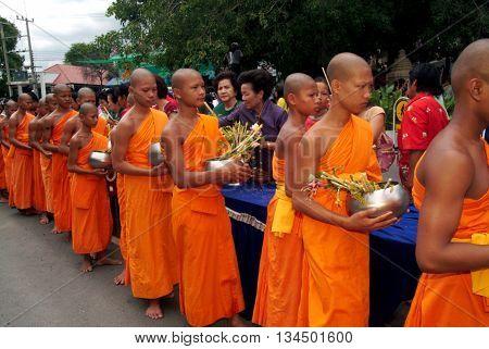 SARABURI THAILAND - JULY 20,2005 : Row of Monks walking to Pagoda in Tak Bat Dok Mai Festival (give flowers to monk) Ceremony at Wat Phrabuddhabat Woramahavihan Temple in Saraburi Province,Thailand.