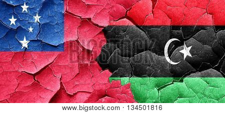 Samoa flag with Libya flag on a grunge cracked wall