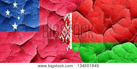 Samoa flag with Belarus flag on a grunge cracked wall