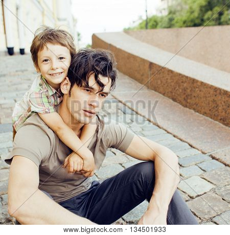 little son with father in city hagging and smiling, casual look outside playing, happy real family, lifestyle people concept, fathers day