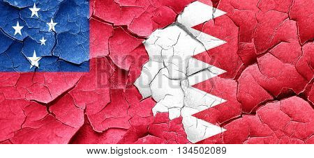 Samoa flag with Bahrain flag on a grunge cracked wall