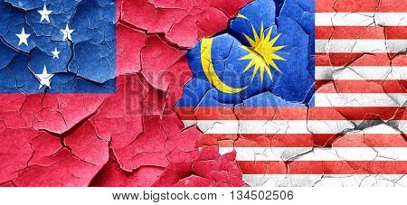 Samoa flag with Malaysia flag on a grunge cracked wall