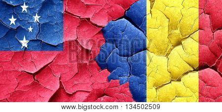 Samoa flag with Romania flag on a grunge cracked wall