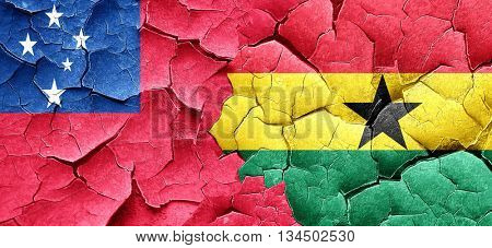Samoa flag with Ghana flag on a grunge cracked wall