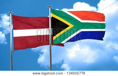 Latvia flag with South Africa flag, 3D rendering