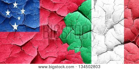 Samoa flag with Italy flag on a grunge cracked wall
