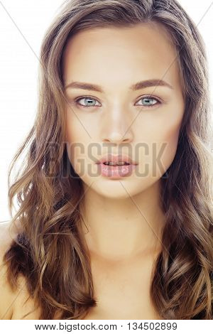 young sweet brunette woman close up isolated on white background, perfect pure innocense, natural makeup