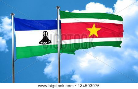 Lesotho flag with Suriname flag, 3D rendering