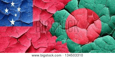 Samoa flag with Bangladesh flag on a grunge cracked wall