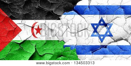 Western sahara flag with Israel flag on a grunge cracked wall