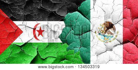 Western sahara flag with Mexico flag on a grunge cracked wall