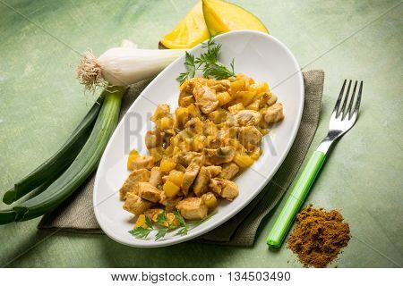 stew chicken with mango and curry