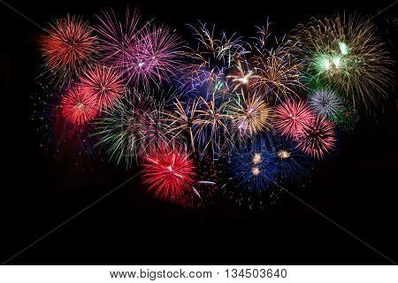 Amazing celebration multicolored sparkling fireworks. 4th of July beautiful fireworks. Independence Day New Year holidays salute.