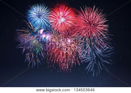 Amazing celebration sparkling fireworks over starry sky. Independence Day New Year holidays salute. 4th of July beautiful fireworks.