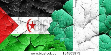 Western sahara flag with Nigeria flag on a grunge cracked wall
