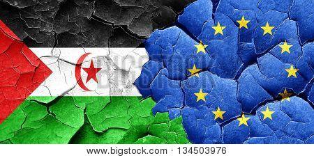 Western sahara flag with european union flag on a grunge cracked