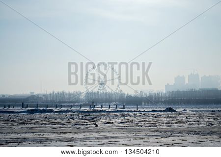Parched riverbed on Russian-Chinese border in winter - view from the Russian side of the border