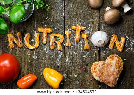 Dough Letters And Vegetables On Rustic Wooden Table, Word Nutrition