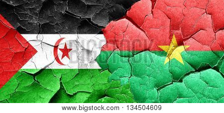Western sahara flag with Burkina Faso flag on a grunge cracked w
