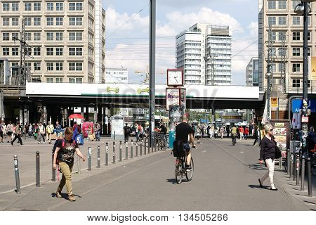 BERLIN, GERMANY - MAY 10: The busy and famous Alexander place with pedestrians and passersby in fine weather on May 10, 2016 in Berlin.