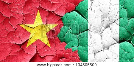 Vietnam flag with Nigeria flag on a grunge cracked wall