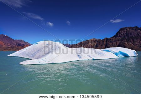 Huge white-blue icebergs float in ice emerald waters of the lake in Argentina.  The unique lake Viedma  in droughty Patagonia