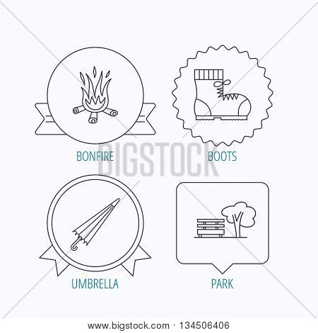 Bonfire, umbrella and hiking boots icons. Park linear sign. Award medal, star label and speech bubble designs. Vector